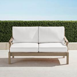 Cassara Loveseat with Cushions in Weathered Finish