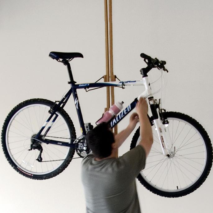 oakrak floor to ceiling bike rack frontgate. Black Bedroom Furniture Sets. Home Design Ideas